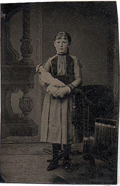 girl holding doll in studio by smieglitz, via Flickr