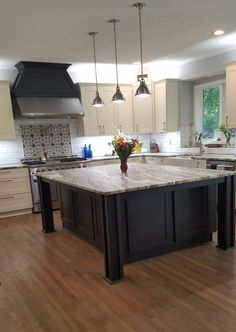 """Amazing remodel in Parkville. Beautiful fantasy brown granite combined with white Shaker cabinetry with a contrasting charcoal gray island ... team up with Italian black and white tile for this sophisticated """"Farmhouse Chic """" kitchen design."""