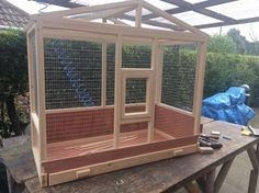 A very attractive Mini Aviary. Size being 48'' long 36'' high and 24'' deep.
