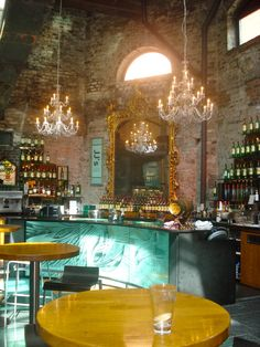 Jameson Whiskey Dublin. Beautiful bar built on the original stone frames from 1780, which could be seen through class floor.
