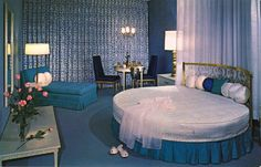"""Downtowner Motel - Boise, Idaho -- Blue, blue, blue, ROUND BED, blue, blue, blue... they are putting the """"something blue"""" into this honeymoon suite."""