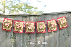 Gorgeous holiday paper rosette banner by DabbleWithDawn on Etsy