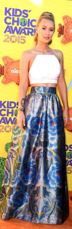 Iggy Azalea Iggy dressed up a simple white crop top by pairing it with a jewel-toned floor-length skirt at the Kids' Choice Awards