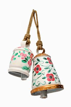 Two elegant bells. Cone and Cylinder shaped. Will add a WOW factor to your wall décor.
