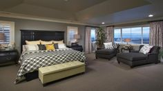 A large Master Bedroom and Sitting Area at Silverleaf by Taylor Morrison