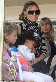 Celebrity Scarf Watch: Heidi Klum wearing a striped sparkly black scarf, with her kids and mother.