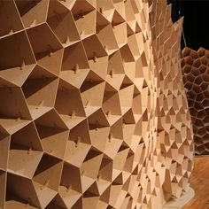 architecture students of the Institute for Lightweight Structures and Conceptual Design (ILEK) at the University of Stuttgart have created an exhibition stand with an irregular honeycomb MDF structure