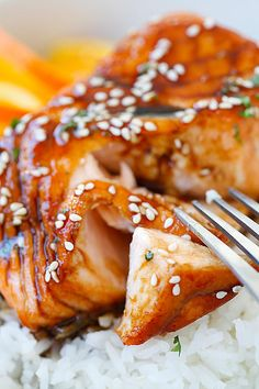 This #quick & easy Salmon with a #flavorful Orange Teriyaki Glaze tastes even more #delicious served over a bed of rice.