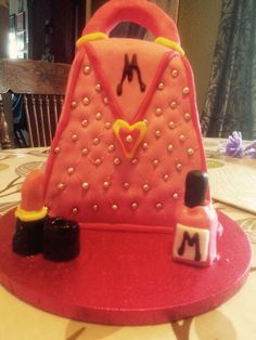 Handbag cake with nail polish and lipstick for my daughter's birthday.