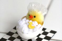 Use toothpicks, buttons, and cut eggshells to embellish and outfit Easter chicks.