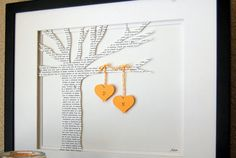 Customize this cardstock tree with the words of the song they first danced to at their wedding.  ($45, domesticnotions.etsy.com)   - CountryLiving.com
