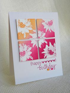 handmade birthday card ... square panel cut into four and mounted slightly split apart ... white embossed images sponged with color bands going from deep red to orange ... gorgeous!!