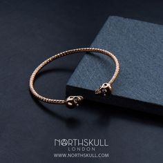 Our Rose Gold Faceted Twin Skull Bangle is handcrafted with meticulous attention to detail. Featuring an open design with a precision cut clear Swarovski crystal set in each eye, the 18kt. Rose Gold finish makes this a sleek & stylish addition to the wrist | Available now at Northskull.com [Worldwide Shipping] #Luxury #Jewelry #MensFashion