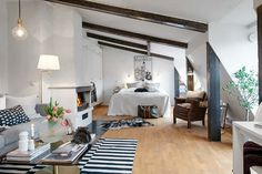 Cute studio in Gothenburg, Sweden. Sloping roof, skylights and exposed beams give character and a warm comfortable feeling. Bright and welcoming with white walls and oak floor. The heart of the apartment,...