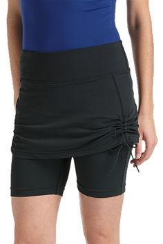 "A cover up and swim shorts built into one piece. Skirted Swim Shorts are mid rise (hits 1 1/2"" below navel), with fashionable ruche on both sides of the skirt. Adjustable skirt pulls lightly up or down on one side. A gripper elastic in back prevents slipping; a convenient pocket on the inside front waistband lets you keep your stuff close. Great for the gal looking for modest swimwear."
