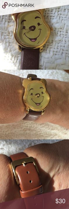 """Disney Commemorative Winnie the Pooh Watch Darling Winnie the Pooh watch! Has Pooh shaped head rimmed in gold. Smiling Pooh face with 2nd hand. Brown leather band with """"Celebrating 80 years"""" embossed In band!  Beautifully made! Perfect for the Disney collector!  Very gently used. Only worn a couple of times! Disney Accessories Watches"""