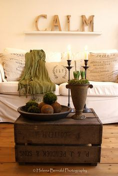 old wooden crate coffee table, printed burlap/linen pillows, kraft colored letters