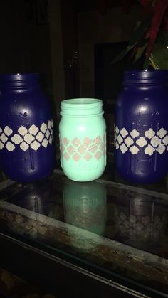 Painted & Stenciled Mason Jars ||Paint the outside of the jar, preferably 3 coats to make it bold and solid. Then wrap a stencil around and paint on top of it (but not too heavily because it will seep through and blend with the design next to it). And finish it off with a coat of mod podge||