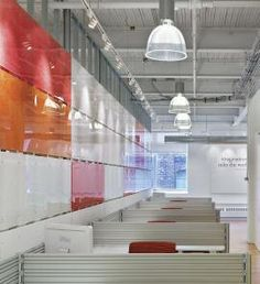 Colorful plexiglass panels with steel studs make effective space dividers