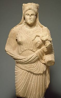 Limestone statue of Aphrodite holding a winged Eros - circa 4th c. BC - at the Metropolitan Museum