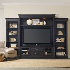 Features:  -Two wood-framed beveled glass doors with one adjustable shelf behind each.  -Two utility drawers with dividers for CD/DVD storage.  -One three plug electrical outlet.  -Removable waist and