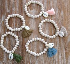 Driftwood Cowrie Bracelet, Wooden Beaded with a Cowrie Shell and Cotton Tassel by ljcdesignss on Etsy https://www.etsy.com/ca/listing/174798148/driftwood-cowrie-bracelet-wooden-beaded