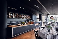 Name: Pescatore Location: Poland Design: Loft Located in the Mera Hotel & Spa, Pescatore stands above most restaurant bars with its. Cafe Bar, Cafe Bistro, Danish Interior Design, Interior Design Companies, Bar Design, Counter Design, Restaurant Concept, Restaurant Design, Black Restaurant