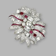 Diamond and ruby brooch, David Webb. Single-cut, emerald-cut, baguette and marquise-shaped diamonds weighing approximately 13.50 carats, mounted in platinum, signed David Webb.