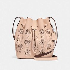 6badcd3ba339a Trendy Women s Bags   Picture Description bucket bag 18 with cut out tea  rose by COACH. Lightweight and spacious
