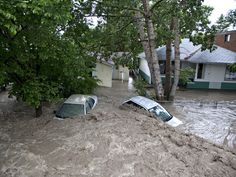 Submerged cars sits in the flood waters in High River, Alta. on June 2013 after the Highwood River overflowed its banks. Just southwest of Calgary. Bragg Creek, Backyard, Patio, Alberta Canada, Natural Disasters, Science And Nature, Calgary, Beautiful World, Naturaleza