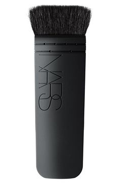 "NARS ""Kabuki"" Brush: designed for contouring and creating a defined, sculpted look."