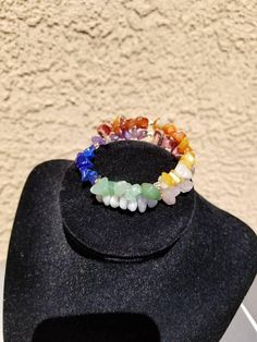 Check out this item in my Etsy shop https://www.etsy.com/listing/541007726/chakra-memory-wire-bracelet