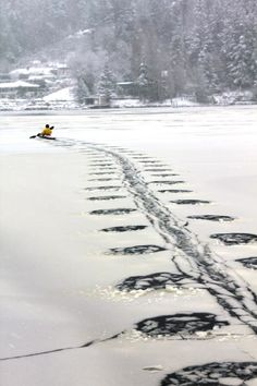 paddling in an icy lake