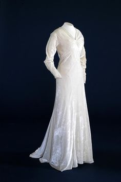 Velvet is in vogue again. Here's a nice example from our stores, an ivory velvet wedding dress from 1934.
