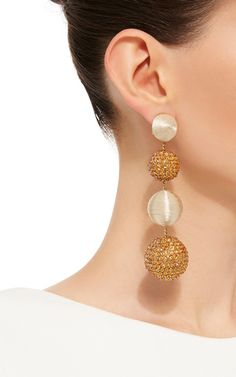 **Rebecca de Ravenel** Le Bon Bons Disco earrings are rendered in a drop style…