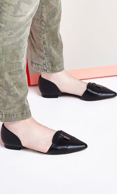 D'Orsay flat with pointed toe and front zipper hardware detail. Also includes elastic at heel to keep your feet from sliding out.