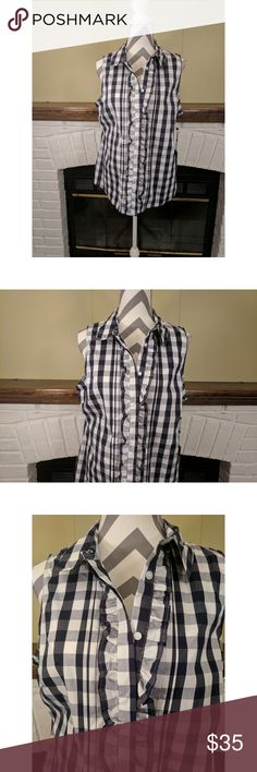 """🆕 Blue & White Checkered Sleeveless Top NWT Tommy Hilfiger blue and white checkered button down top with ruffled design around buttons. 70% cotton 27% nylon 3% spandex. Measures 19"""" from armpit to armpit and 27"""" in length. 🚭 Smoke free home. Tommy Hilfiger Tops Button Down Shirts"""