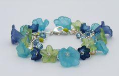 Lucite Flower Bracelet Sterling Silver - Aqua, Navy and Lime. $55.00, via Etsy.