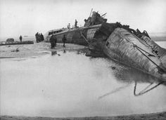 A wrecked German submarine at Calais used to try to break the British naval blockade of Germany. 1915  Pictorial Press