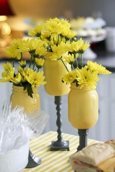 I LOVE this idea.  Painted mason jars with painted candle sticks for pedestals.