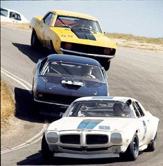 Nice Laguna Seca shot of Firebird, 'Cuda, Camaro. From one of the best years the Trans Am series ever had.