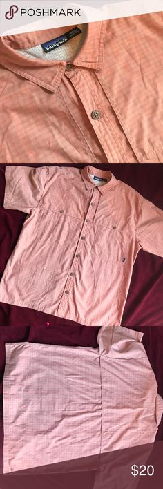 Patagonia Button Down Shirt Sleeve Patagonia Button Down Shirt Sleeve. Size Large. Light arrange or rust color. Preowned in great condition with no tears snags or stains. Comes from smoke free and clean home. Patagonia Shirts Casual Button Down Shirts