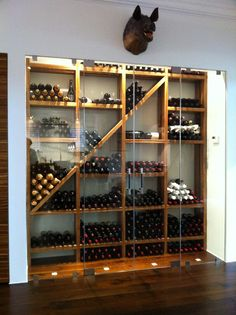Contemporary styled wine cellar. Racking constructed of 8/4 solid Zebra wood