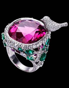 Piaget Limelight Garden Party ring in 18K white gold, set with one pink cushion-cut rubellite (approx. 33.98 ct), 16 pear-cut emeralds (approx. 3.58 ct), 8 pink brilliant-cut sapphires (approx. 0.58 ct) and 359 brilliant-cut diamonds (approx. 3.75 ct).