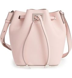 Lightly textured leather and polished silvertone hardware detail a retro-chic bucket bag that pulls together your street style with poise and polish.