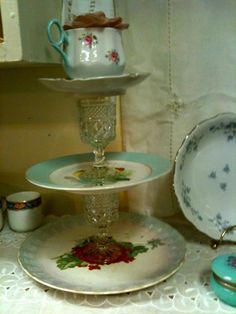 Hand made vintage china dessert stand with a tea cup on top for fresh flowers
