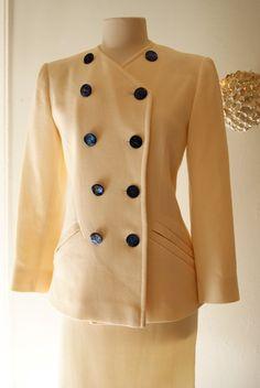 Vintage YSL Yves Saint Laurent Ladies Cream 2 pc Dress Suit 1980s Designer Set Size 12. $125.00, via Etsy.