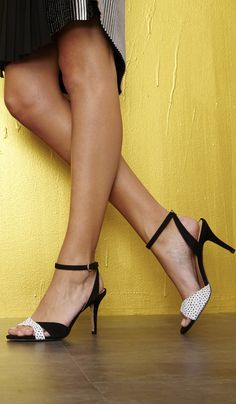Strappy heel with a sleek adjustable ankle strap and a crisscrossed open toe.