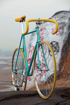 Turquoise and yellow track bike