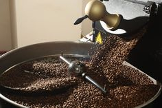 The sweet smell of success! CareerConnect profiles blind entrepreneur and master coffee roaster Gerry Leary. (Image: freshly roasted coffee beans spilling out of a coffee roasting machine)